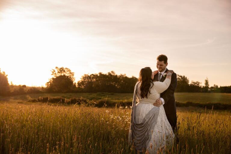 Wedding Couple in Field at Sunset